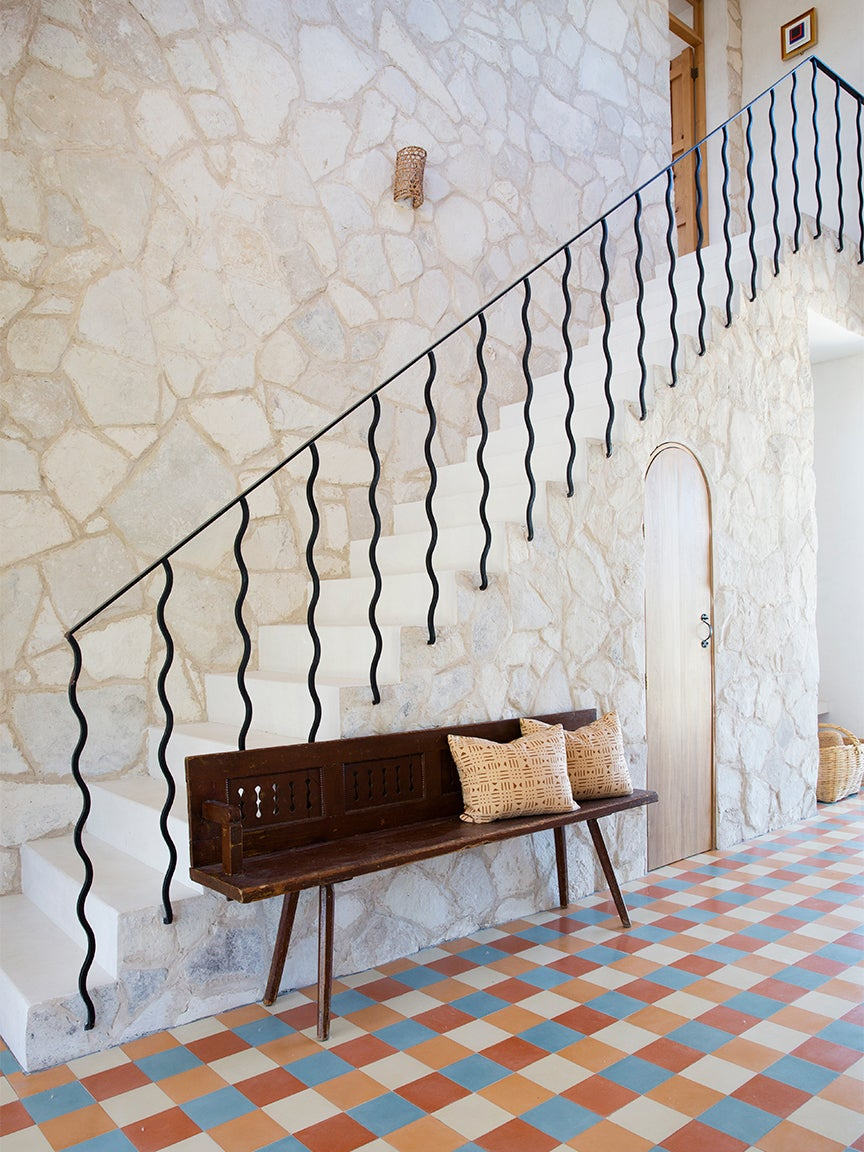 hallway with sculptural staircase