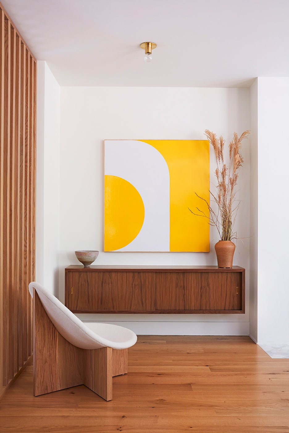 floating credenza with yellow art