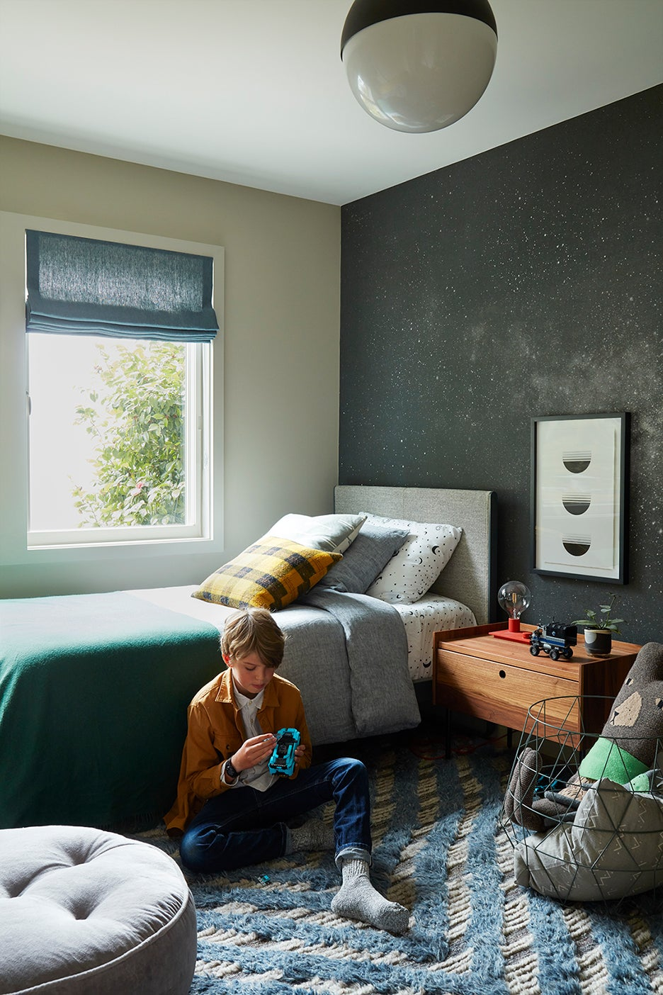 boy in space themed room