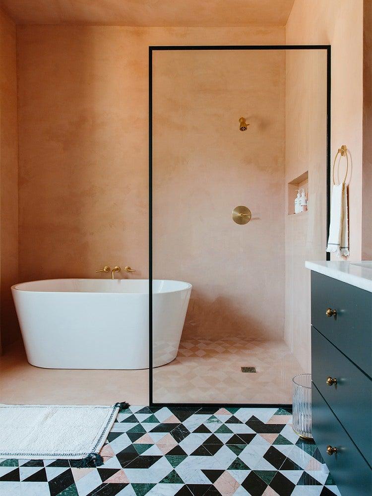 pink showerwalls with graphic floor tiles