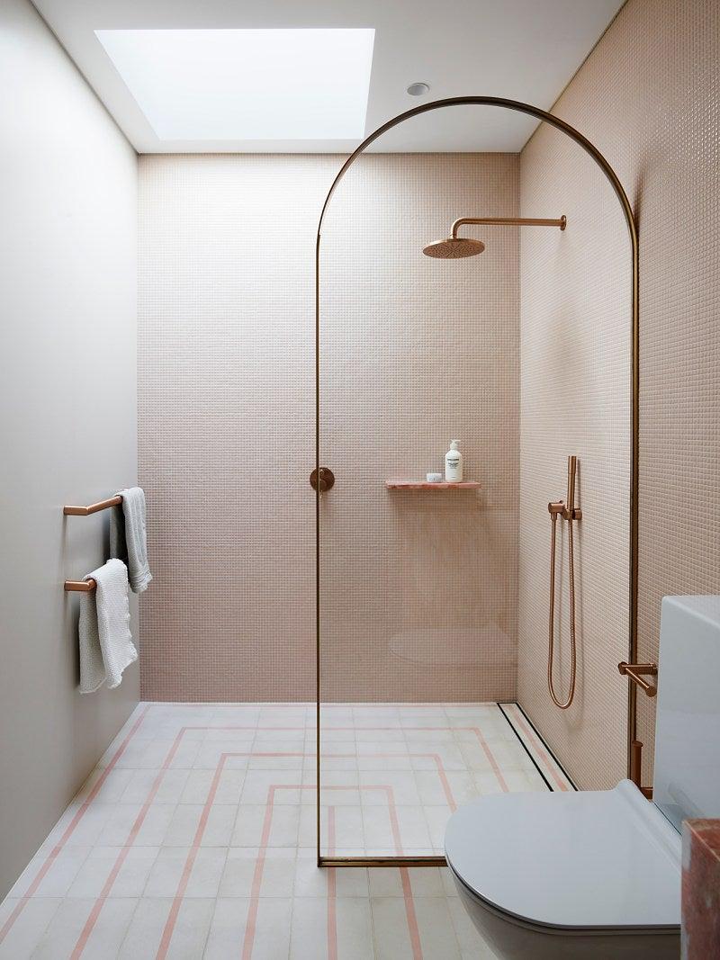pink bathroom with skylight