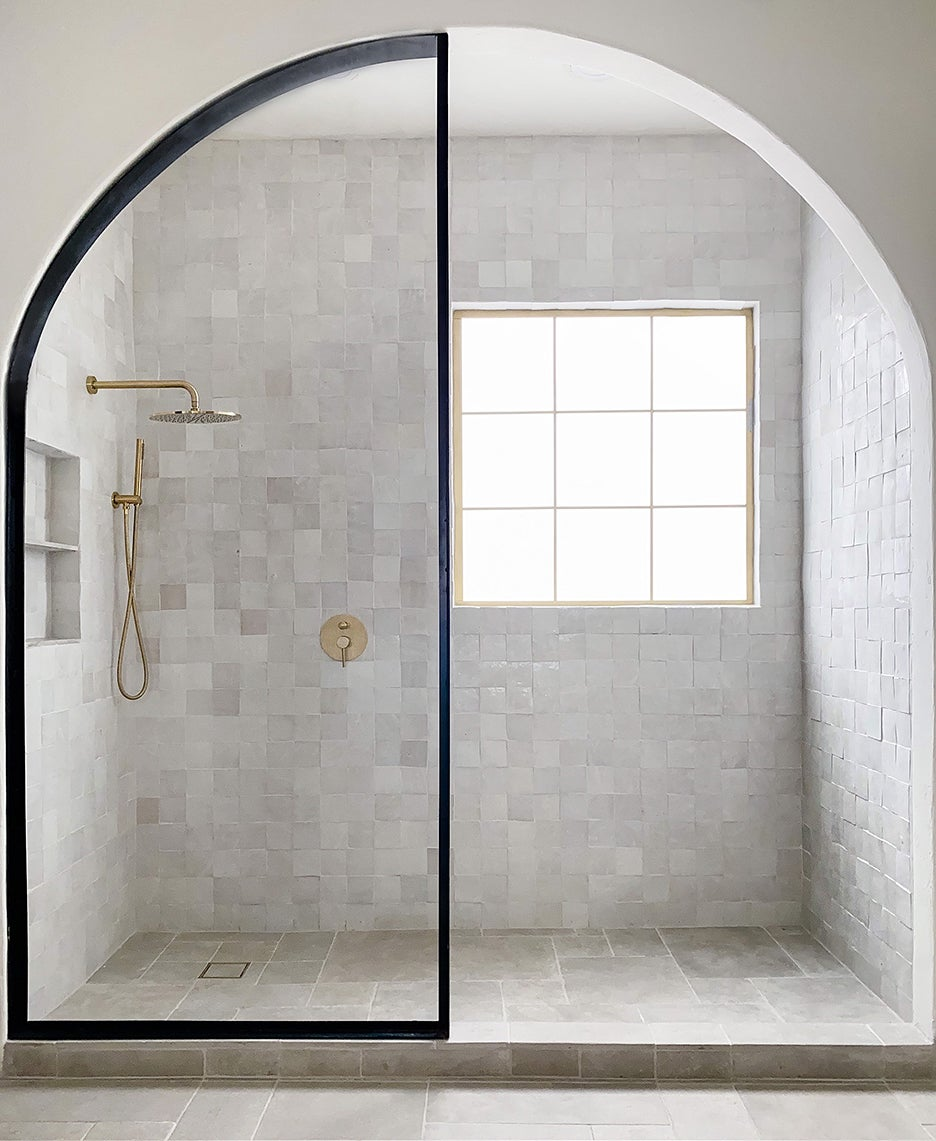 archway leading to white shower