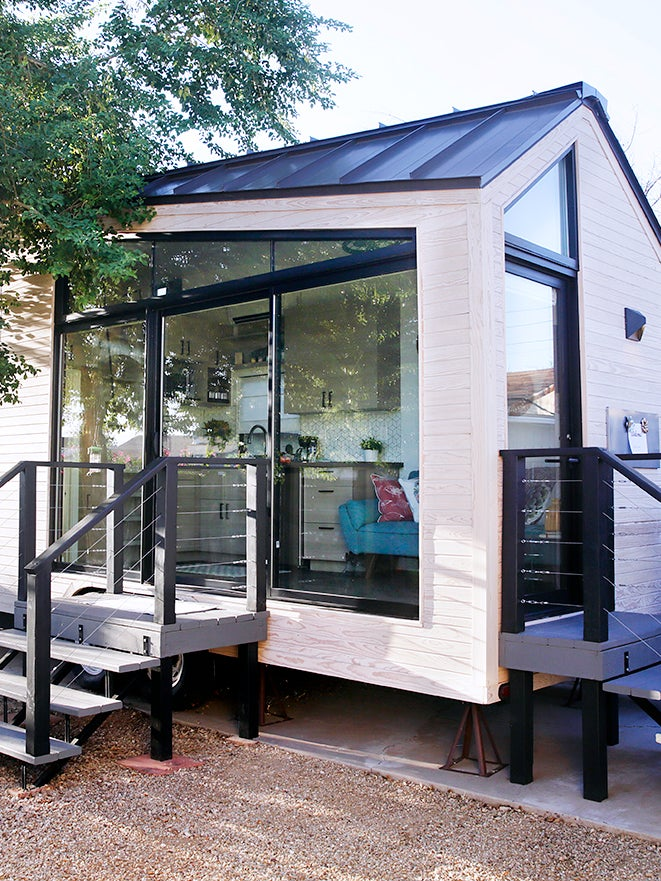 white tiny house with black details