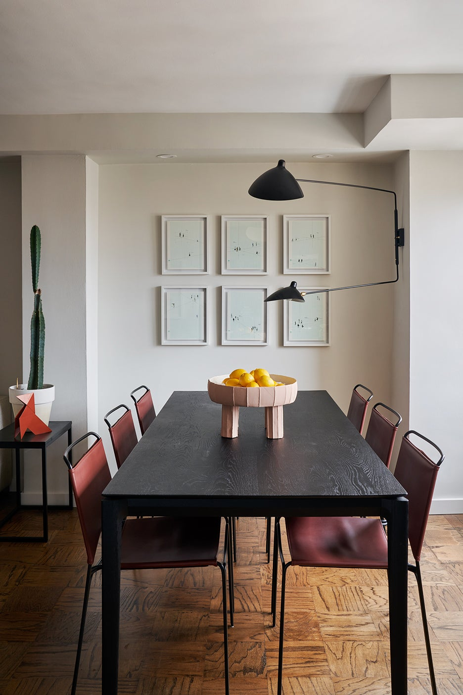 Dining room with wall sconce and leather chairs