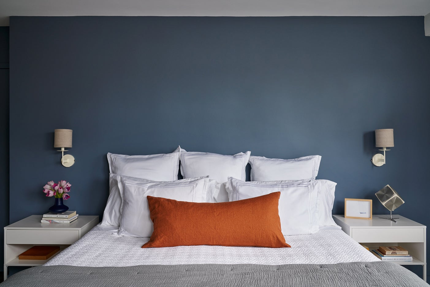 Blue bedroom with white linens
