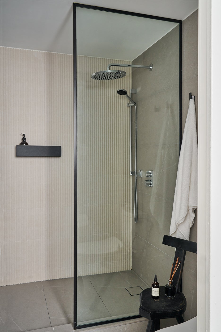 Walk-in shower with striped tile
