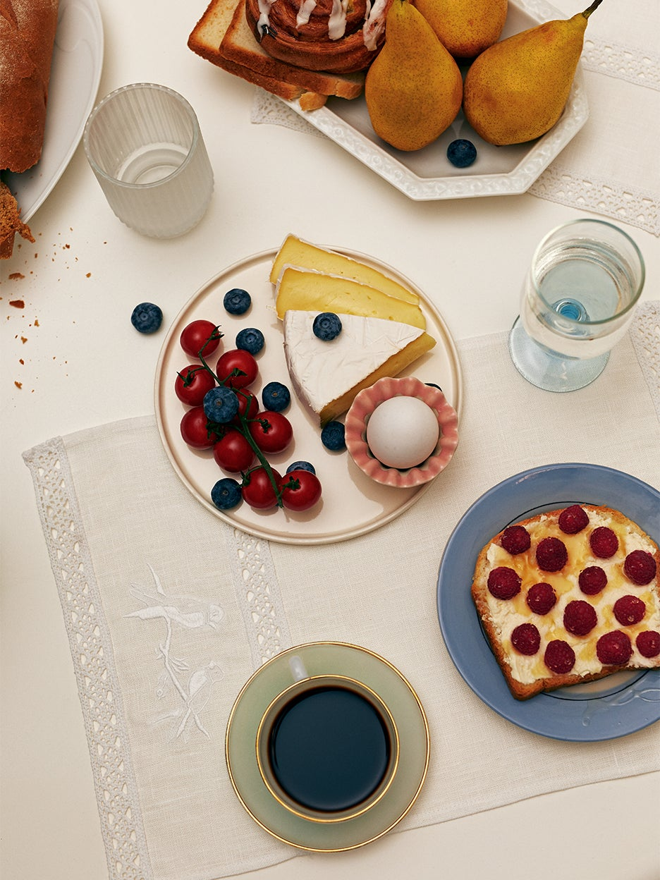 Tabletop with embroidered napkin