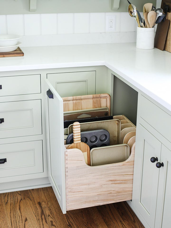 open kitchen cabinet with cutting boards inside