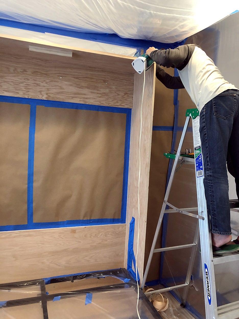 man putting together wood frame
