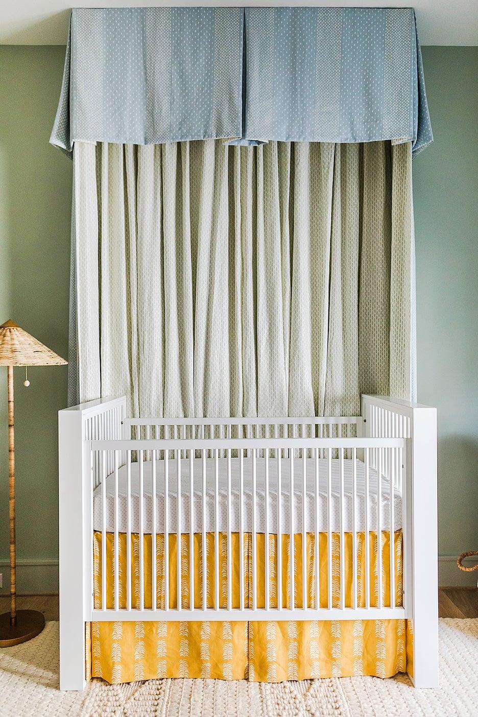 a nursery with canopy crib