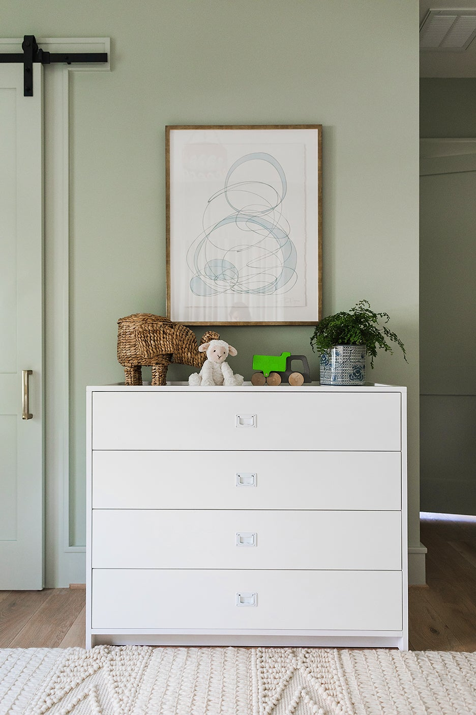 a nursery with a dresser
