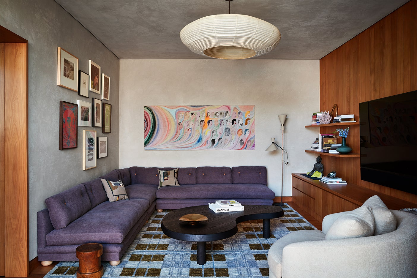 purple couch and wood wall