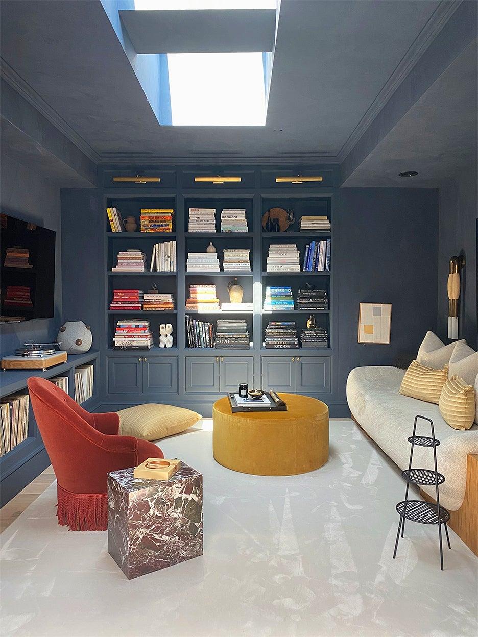 dark blue room with white rug