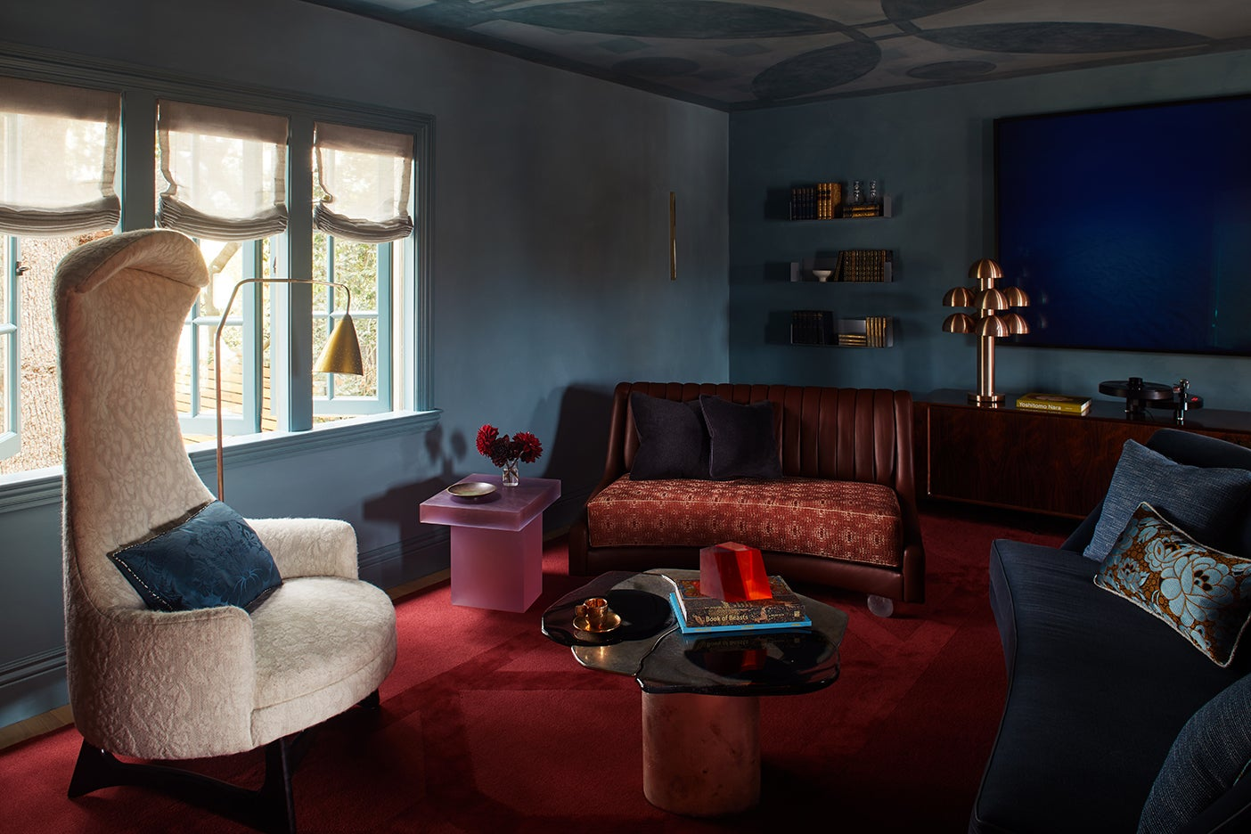 cozy lounge space with red rug