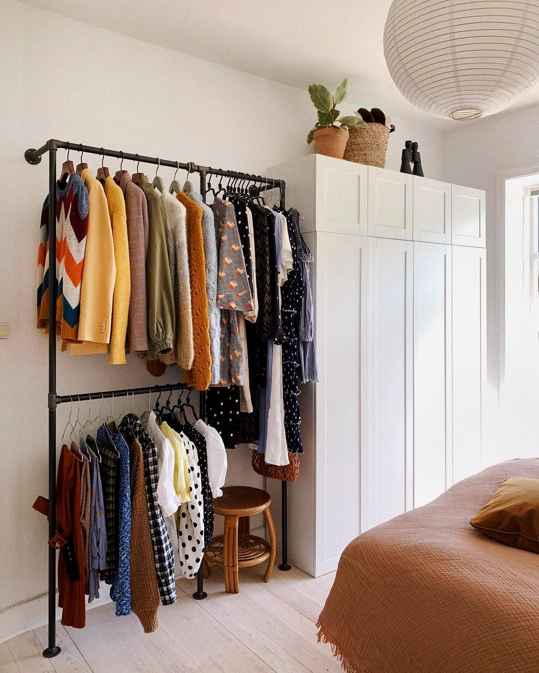 clothing rack next to built in wardrobe