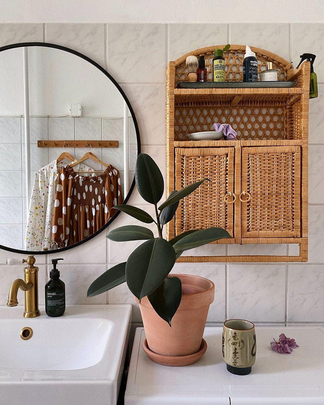 rattan shelving unit in bathroom