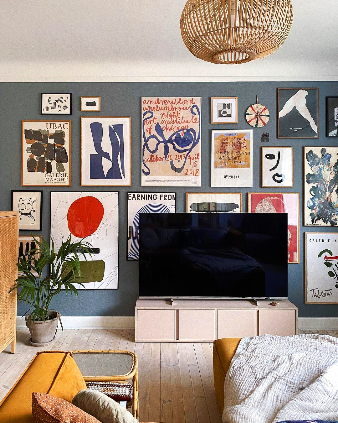 blue iving room with eclectic gallery wall