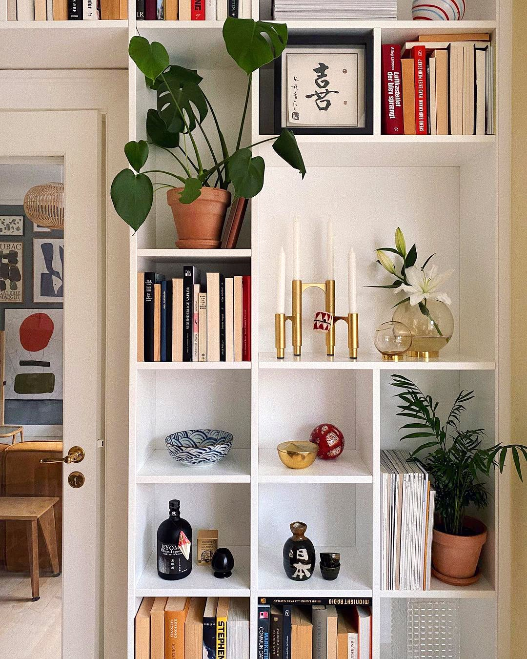 open bookshelves stocked with candles