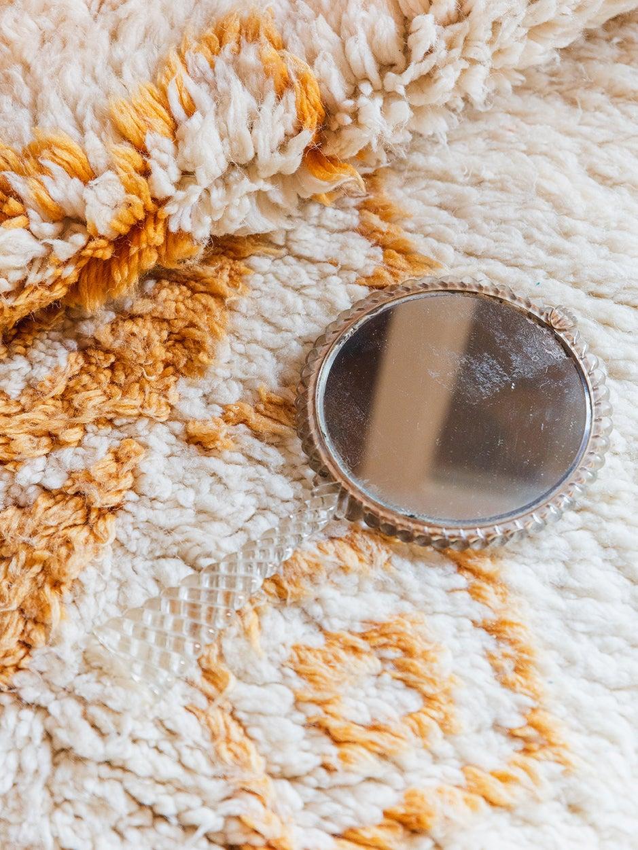 mirror on a rug