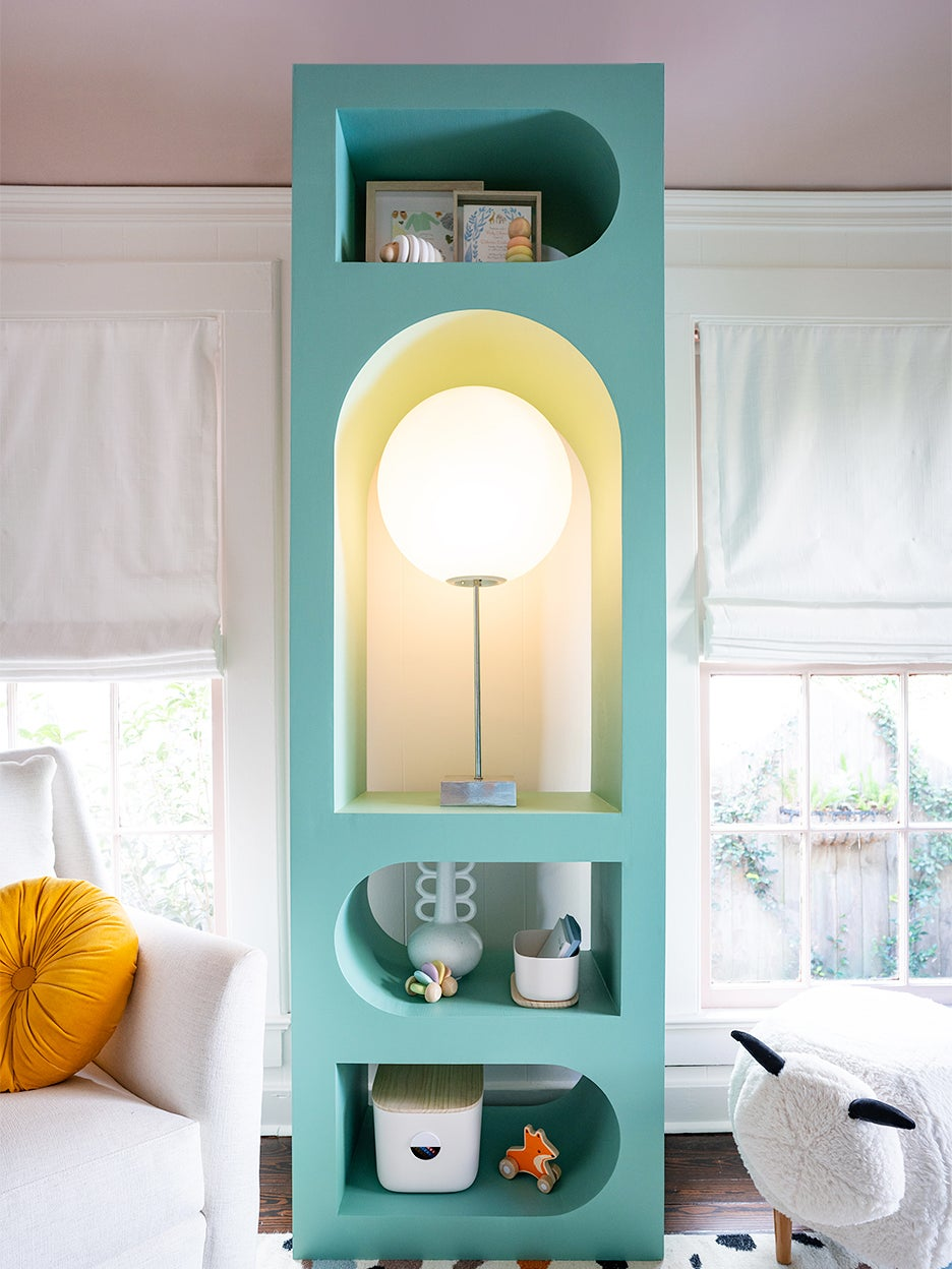 blue bookcase with bright lamp