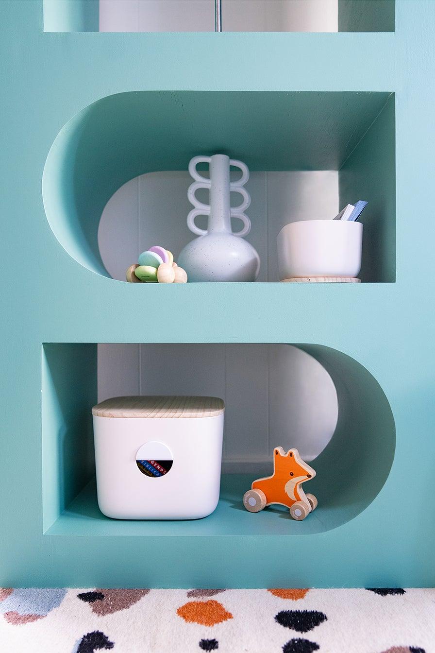 vase and bins on shelf