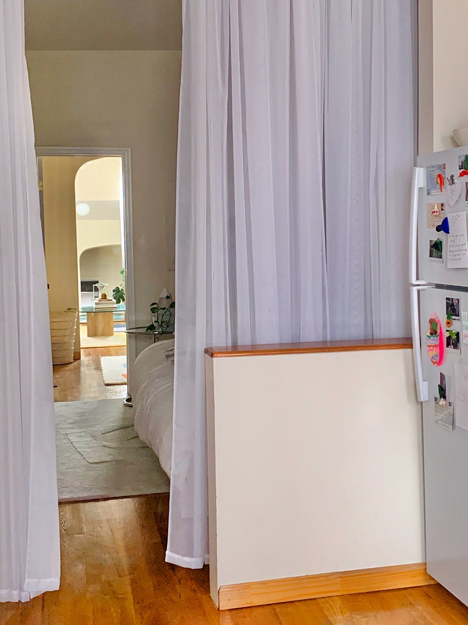a fabric divider in a room