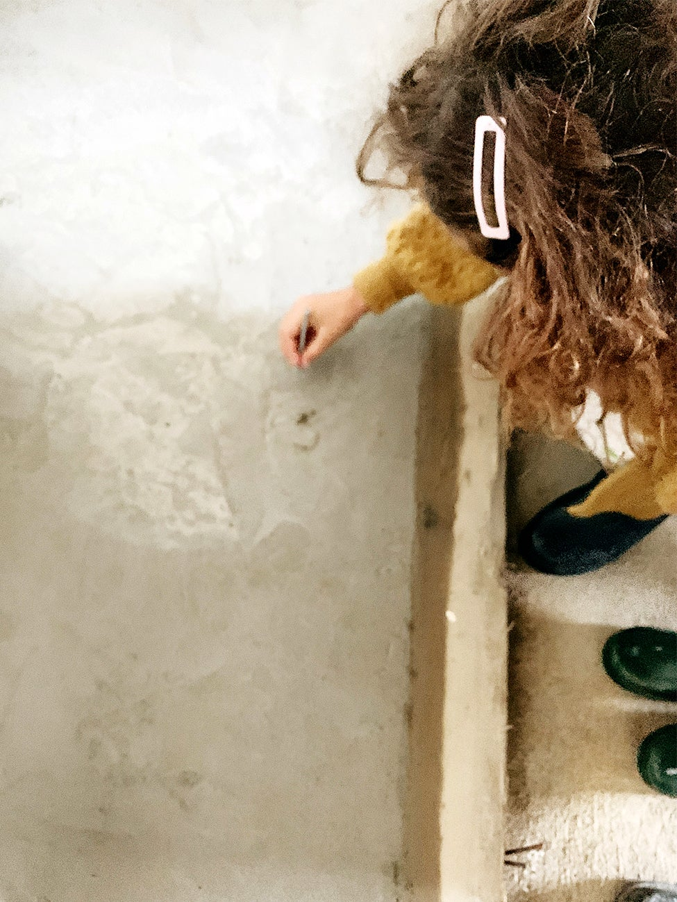 girl drawing in cement