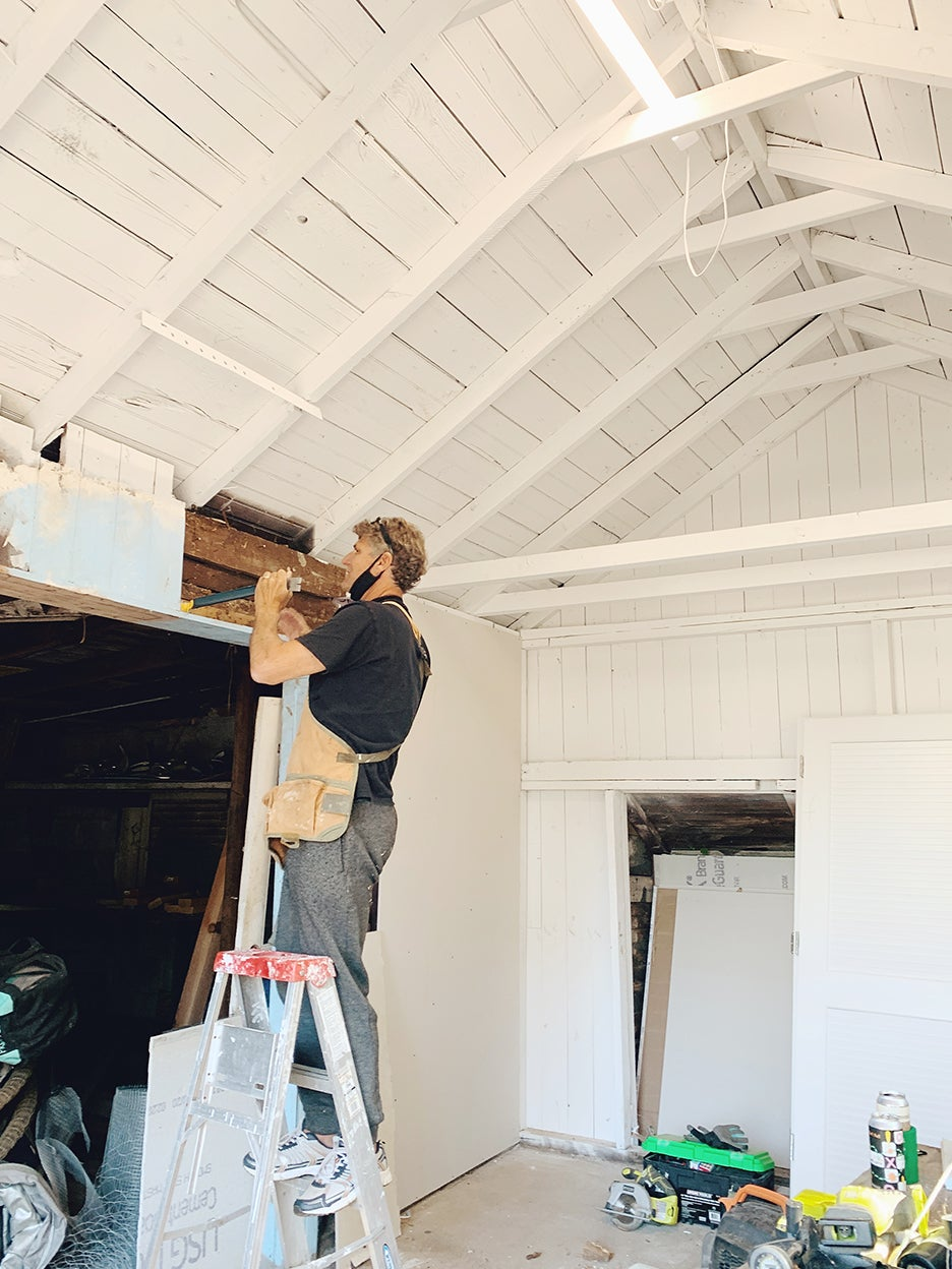 man working on ceiling