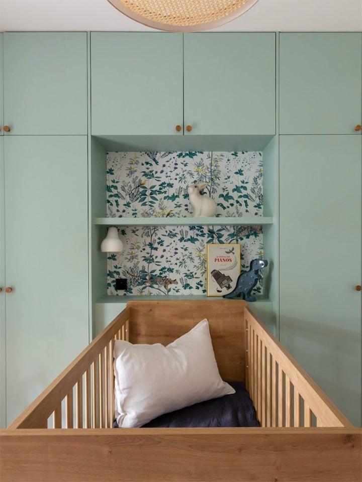 Sage green kids bedrooms - nursery with green custom closet