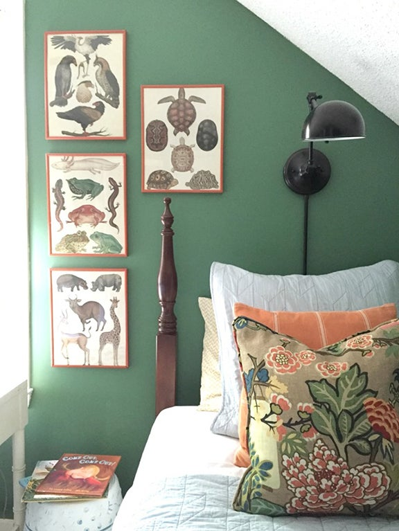 Sage green kids bedrooms - green accent wall with artwork above bed