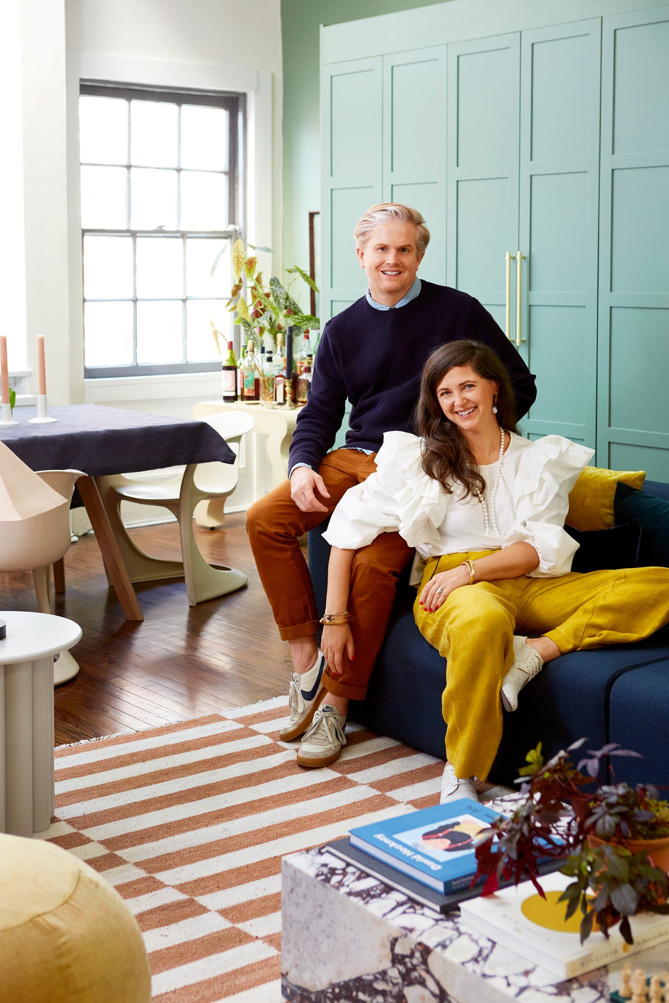couple sitting on sofa in living room