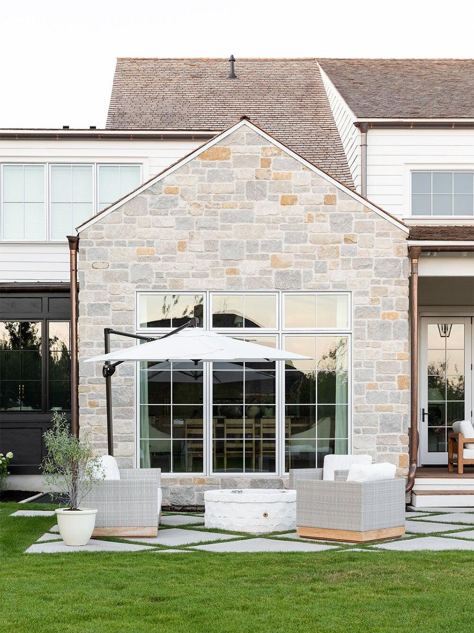 stone hosue with grassy yard