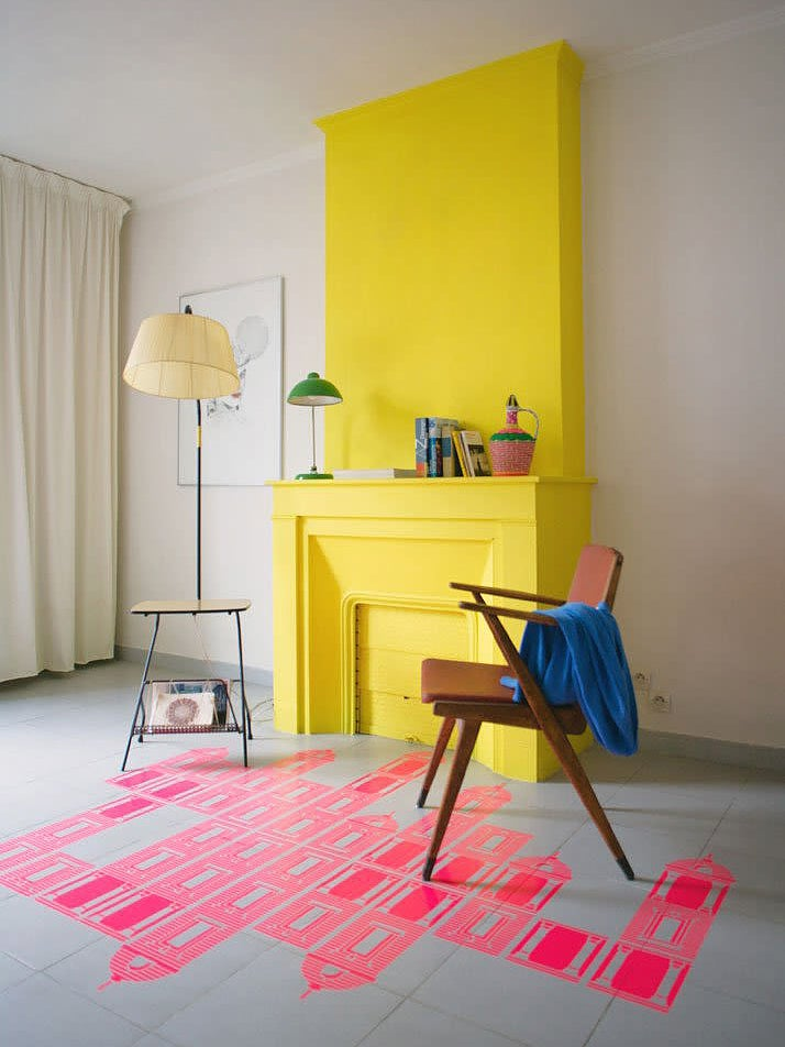 bright yellow fireplace with pink building floor desing