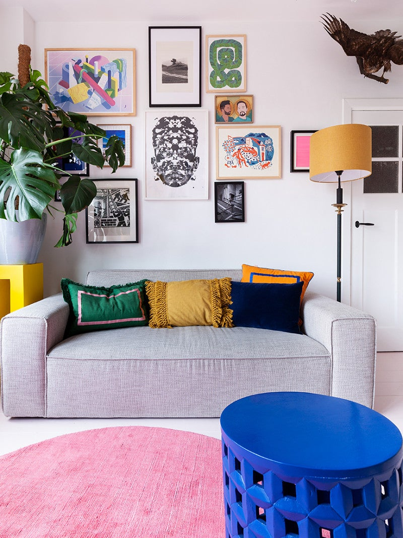 living room with art and pink rug