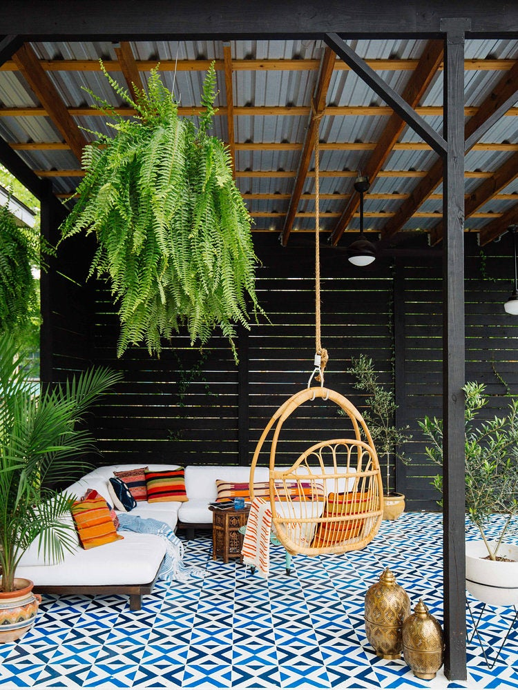 breezy outdoor sitting area under a metal roof