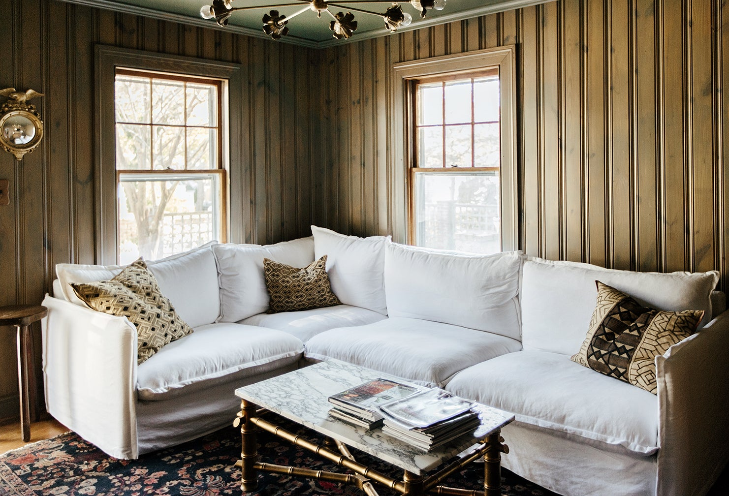 cozy green den with white couch