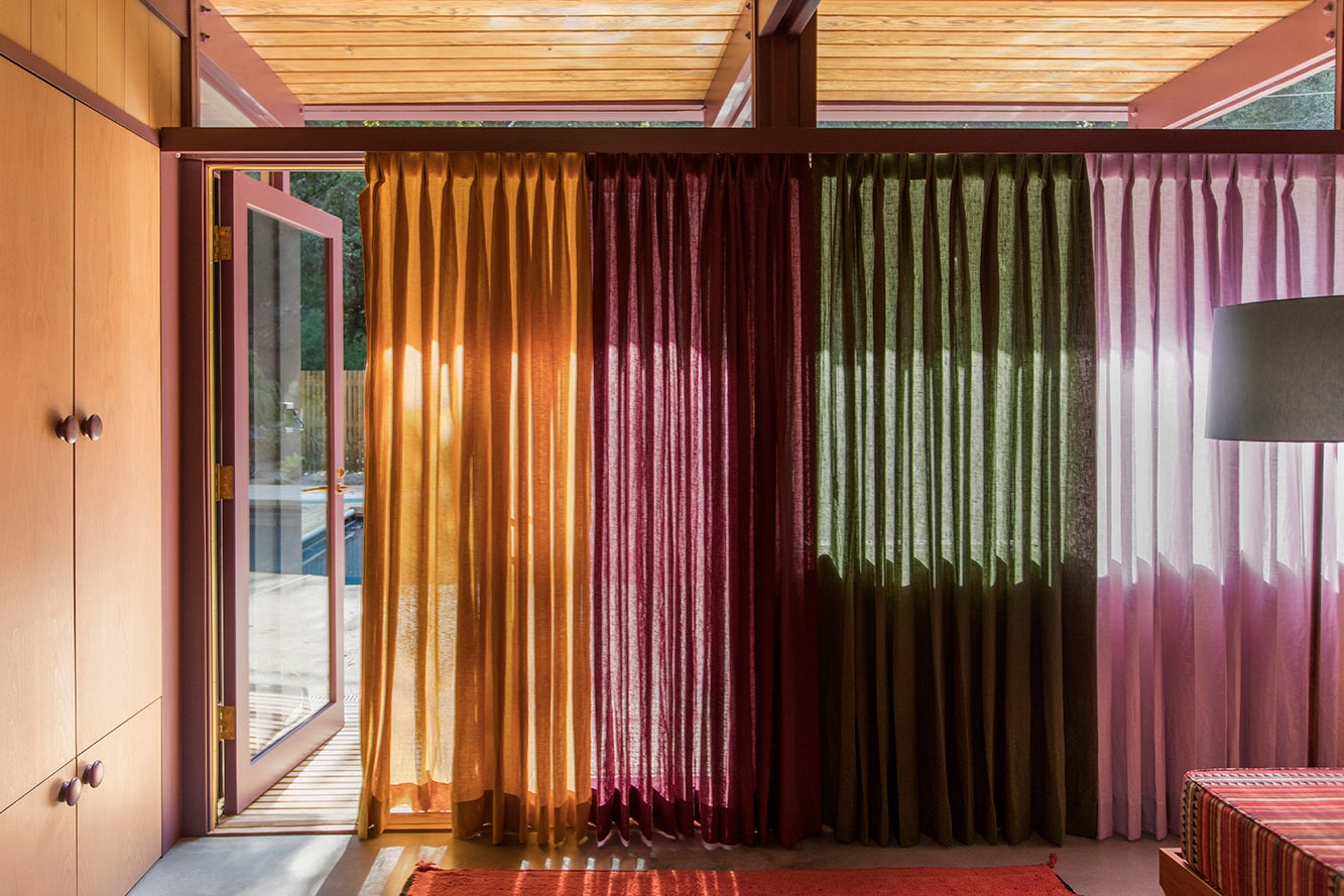 curtains running across a room