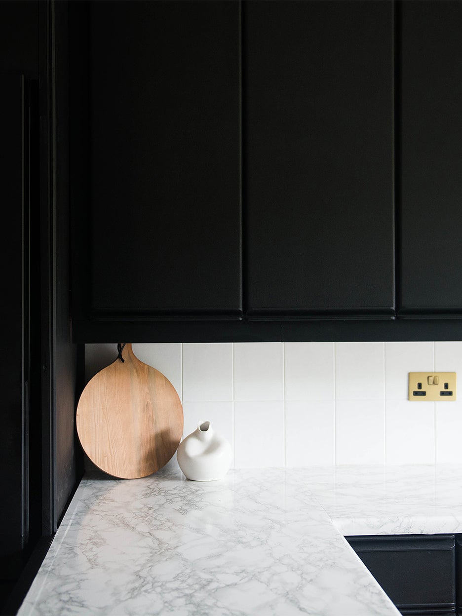 black cabinets with white counter