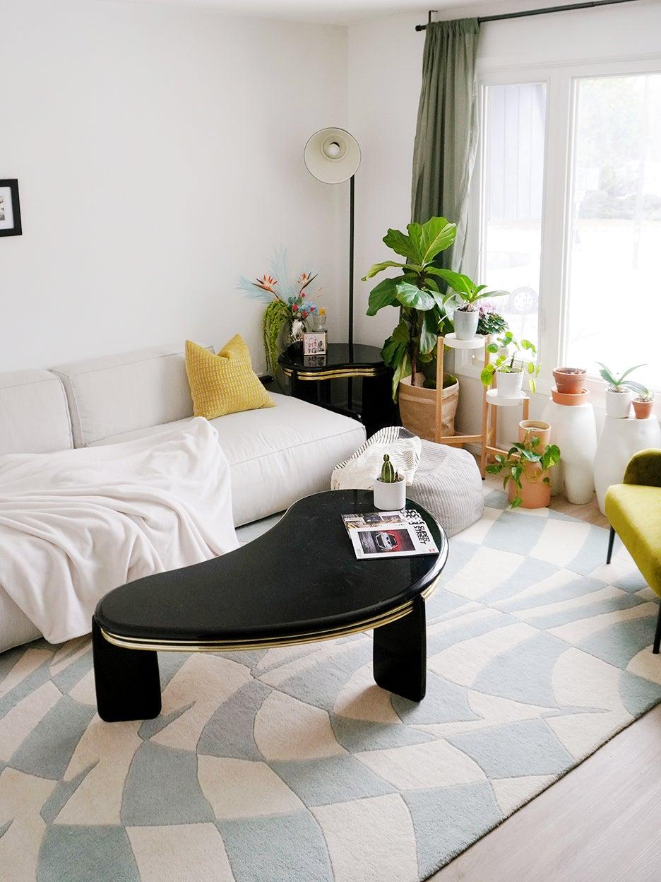 black coffee table on checkered rug