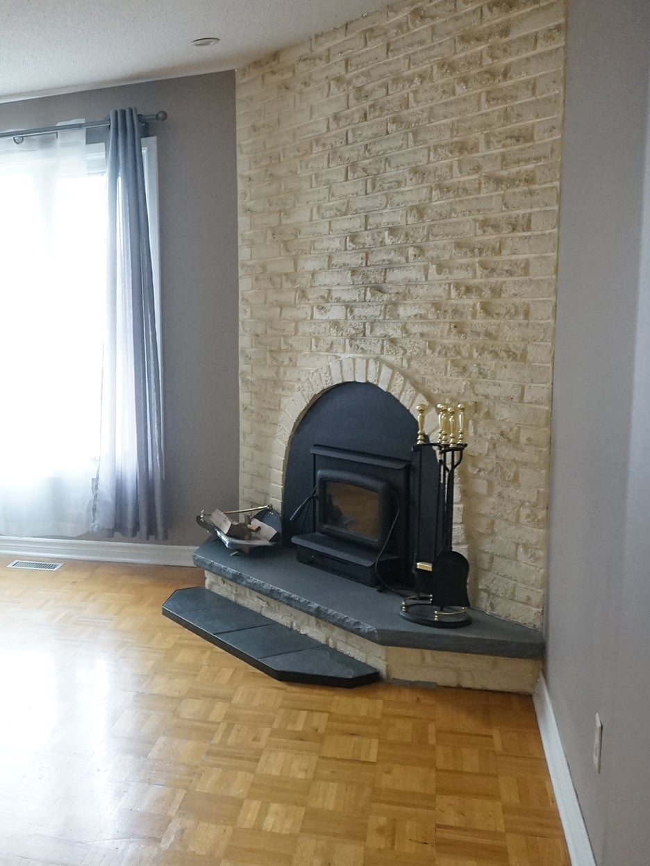 dated brick fireplace and parquet floors