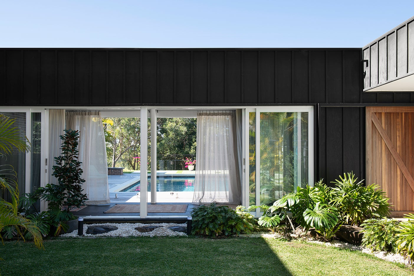 black house with grassy yard