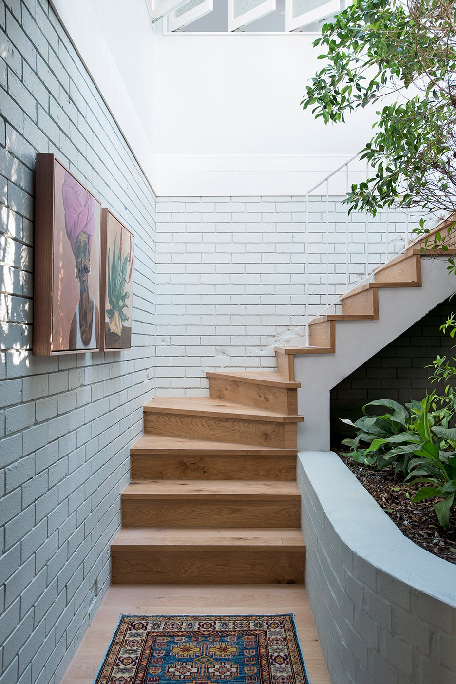 stairwell lined with white bricks