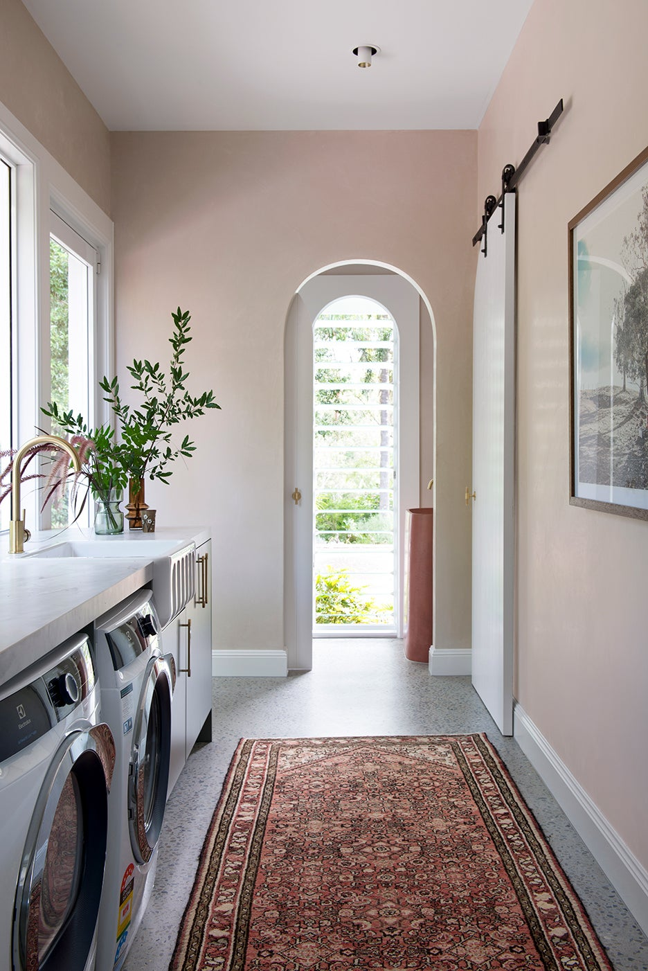 pink laundry room with arches