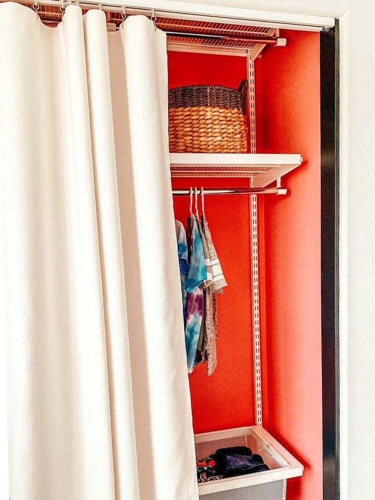 red closet with fabric panel