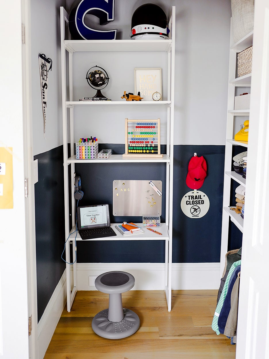 blue boys closet with work space