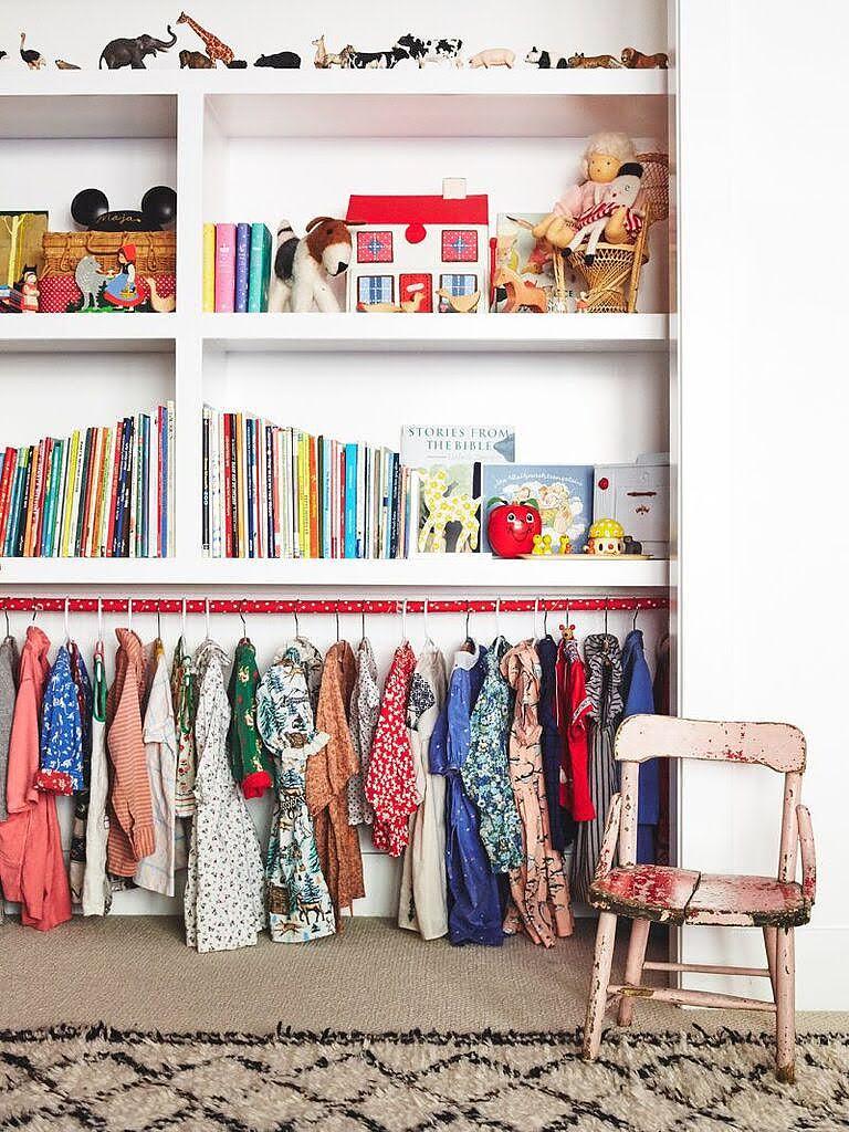 clothes hangign below bookshelf