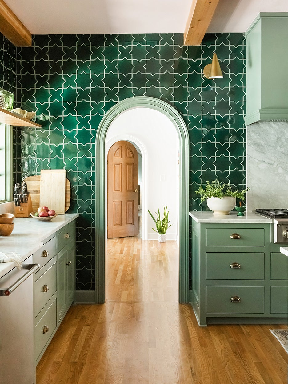 arched doorway in kitchen surrounded by green tiles