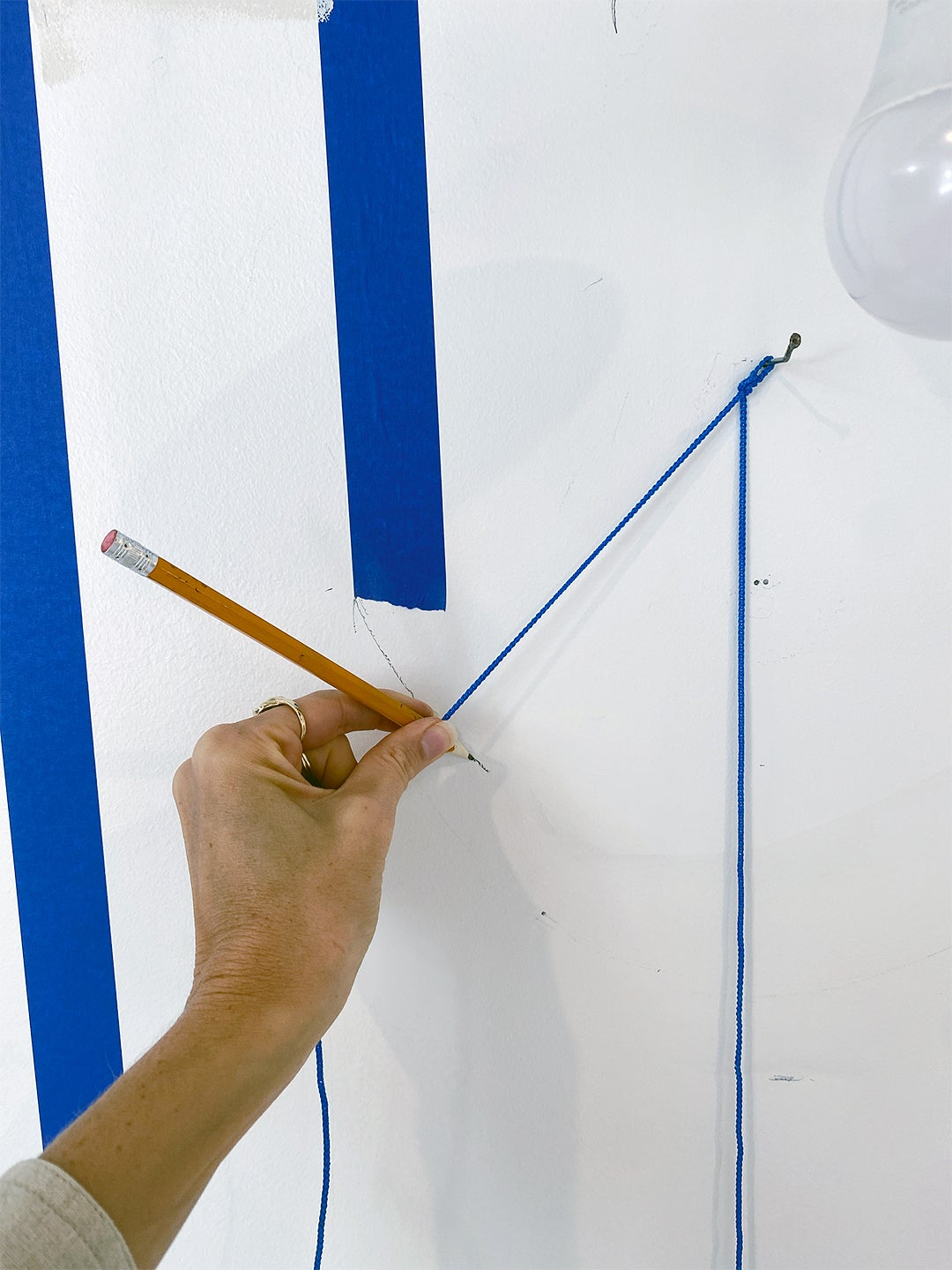 measuring with a pencil and string