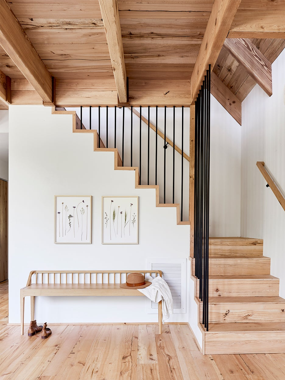 Wooden stairs with wooden bench at base