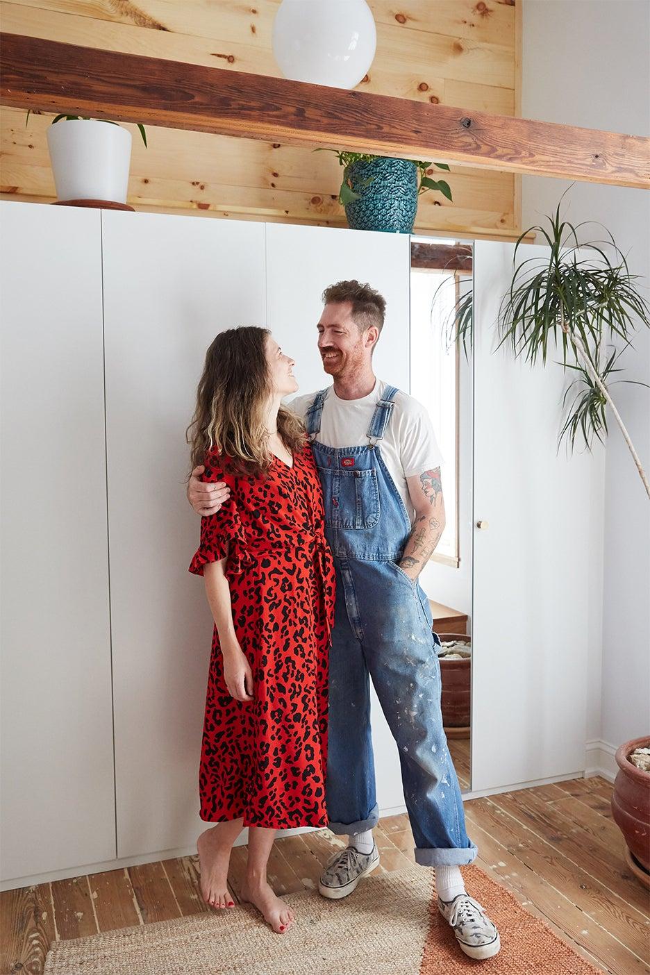 couple standing in bedroom
